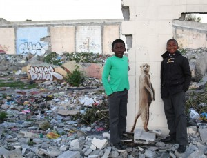 two kids posing with graffiti in gugulethu
